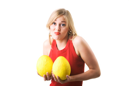 A woman considering a breast augmentation (metaphor, skeptical) Stock Photo