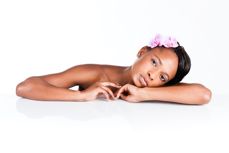 Young African woman in Studio doing body care and taking bath for young and beautiful skin and relaxation