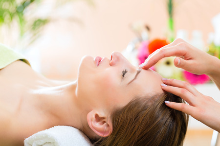 face massage: Wellness - woman receiving head or face massage in spa