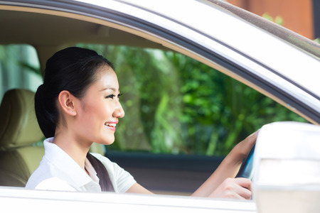 Asian woman driving new car photo