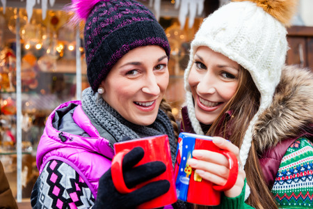 Friends drinking eggnog on Christmas Market photo