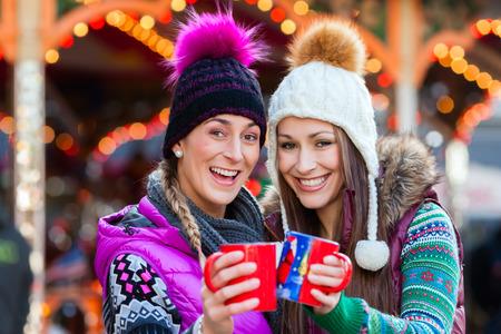 Friends drinking eggnog on Christmas Market