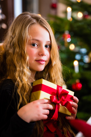 boxing day: Girl with Christmas gift on boxing day