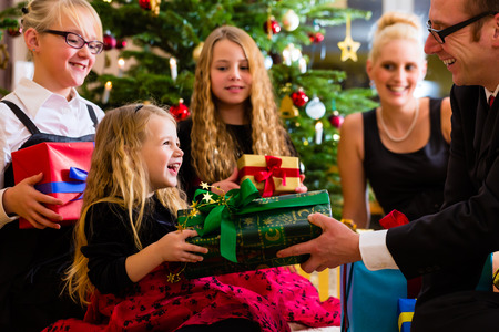 Parents and children with presents on Christmas day photo