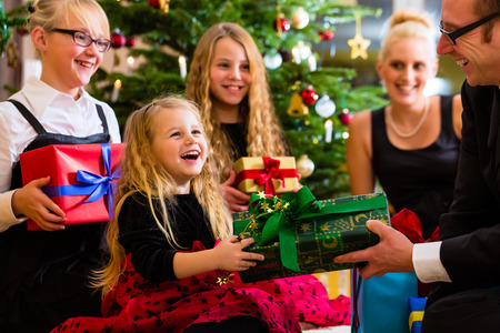 christmas day: Parents and children with presents on Christmas day Stock Photo