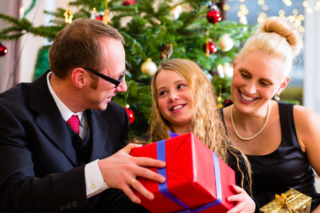 boxing day: Parents and daughter with Christmas gifts on boxing day