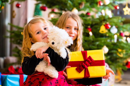 christmas day: Children receiving presents on Christmas day Stock Photo