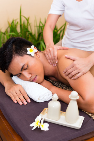 Indonesian Asian man in wellness beauty spa having aroma therapy massage with essential oil, looking relaxed photo