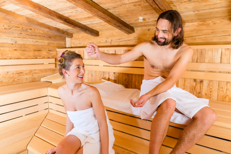 cool down: Couple relaxing together in wellness spa sauna with ice to cool down Stock Photo