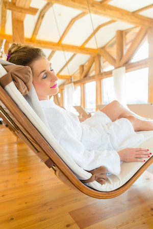 Woman relaxing on wellness spa lounger photo