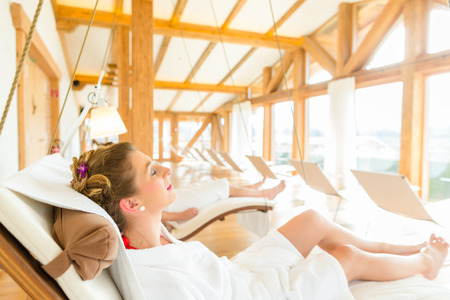 bath robes: Woman relaxing on wellness spa lounger