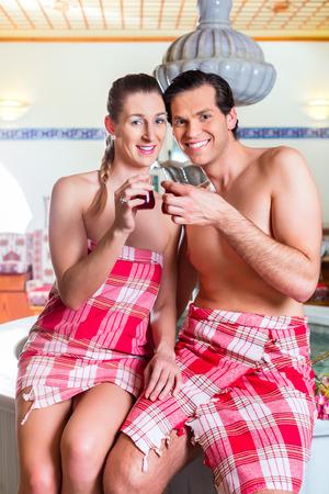 haman: Couple drinking Turkish tea in wellness spa Stock Photo