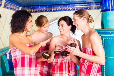 vapour: Women in Hammam vapour bath with wellness peeling