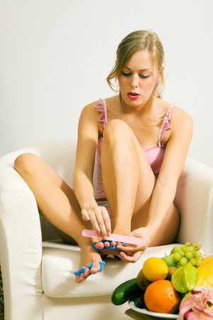 mingle: Blonde girl spending some girl time to do a pedicure