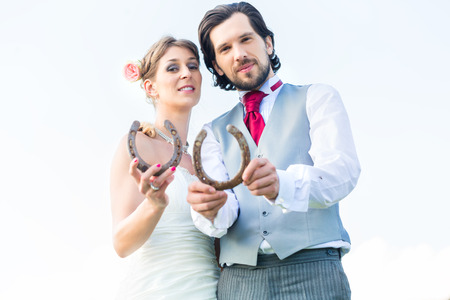 horse shoe: Wedding bride and groom showing horseshoe symbol for luck