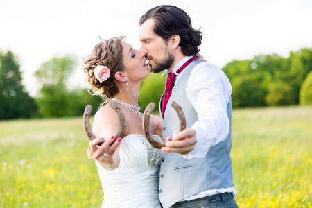 horse shoe: Wedding couple showing horse shoe