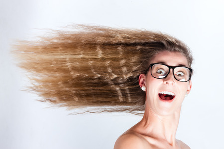 forward: Long hair of woman blowing in head wind Stock Photo