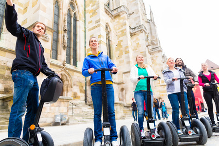 discovering: Tourist group having guided Segway city tour in Germany