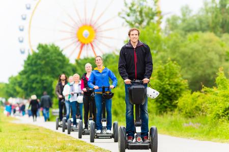 Tourist group having guided Segway theme park tour