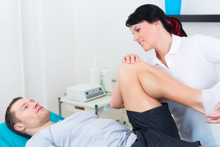 physical injury: Patient at the physiotherapy doing physical exercises with his therapist