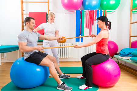therapist: Patients at the physiotherapy doing physical exercises with therapist