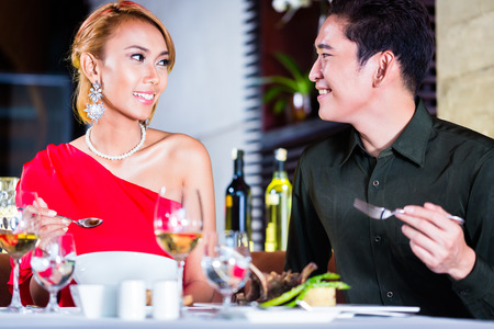 fine: Asian couple fine dining in fancy restaurant Stock Photo