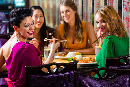 couple dining: Young people eating in Asia restaurant Stock Photo