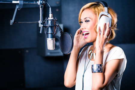 Asian professional musician recording new song or album CD in studio Stok Fotoğraf - 33749470