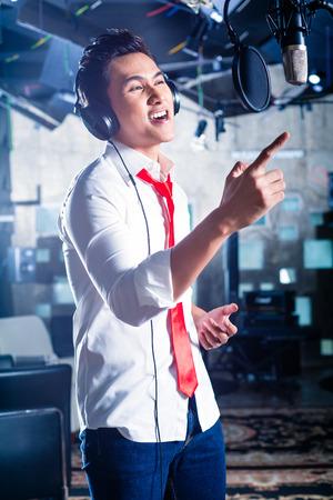 pop singer: Asian professional musician recording new song or album CD in studio