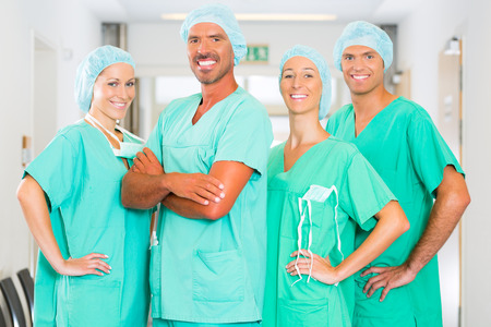 anesthetist: Hospital - medical surgery team is ready for the operation, the women and men wearing scrubs in a clinic