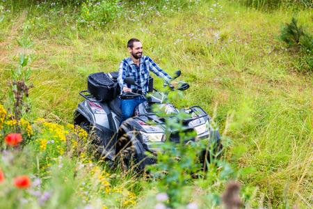 quad: Man driving off-road with quad bike or ATV