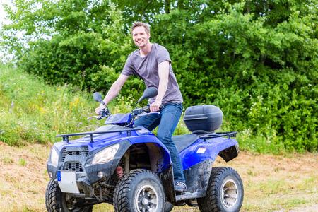 atv: Man driving off-road with quad bike or ATV