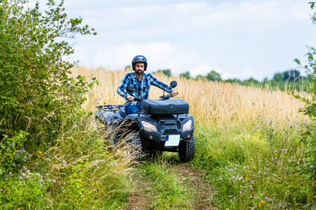 atv: Man driving off-road with quad bike or ATV