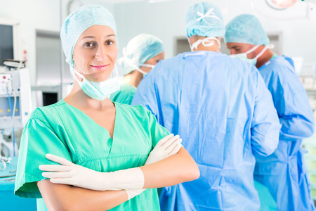 Hospital - surgery team in the operating room or Op of a clinic operating on a patient in emergency photo