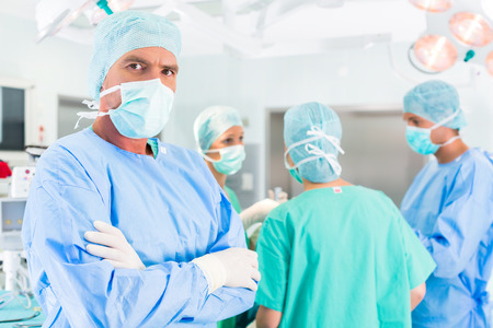 Hospital - surgery team in the operating room or Op of a clinic operating on a patient, perhaps its an emergency photo