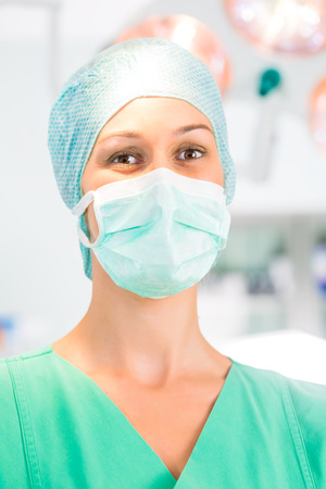 anesthetist: Hospital - Young female doctor or surgeon in a sterile operating room, theater or clean room of a clinic Stock Photo