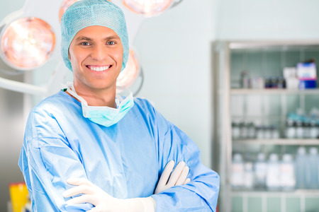 anesthetist: Hospital - Young male doctor or surgeon in a sterile operating room, theater or clean room of clinic