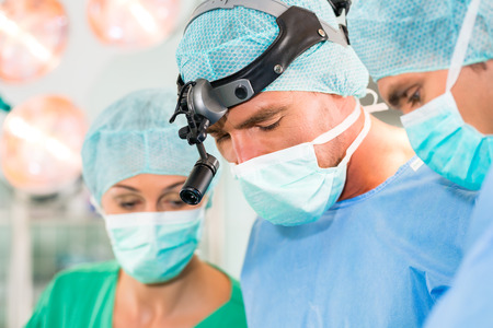 anesthetist: Hospital - surgery team in the operating room or Op of clinic operating on patient in an emergency situation