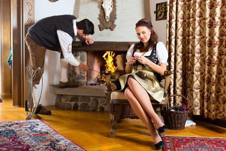 hunter's cabin: Couple in a traditional mountain hut with fireplace