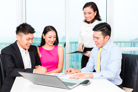 insurance consultant: Asian banker team counseling client finance investment in bank office
