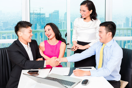 bankers: Asian banker team counseling client finance investment in bank office