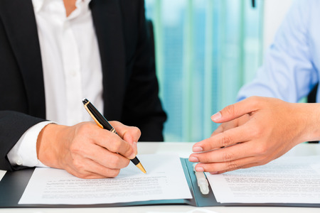 agreements: business people sign agreement