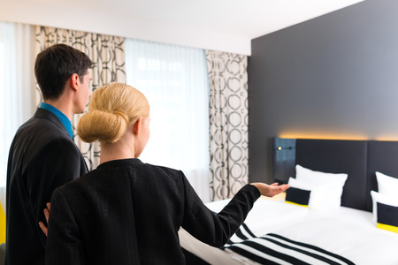 Man and woman arriving  in hotel room photo