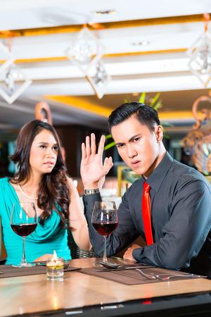 Asian Couple arguing in restaurant photo
