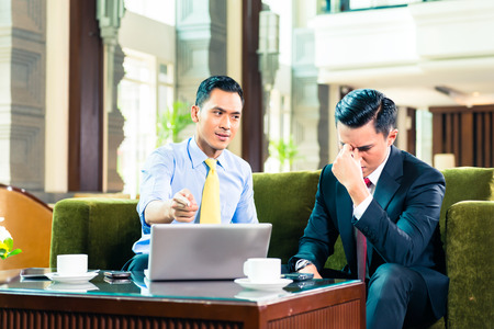 Asian Businessman thinking while having a meeting photo