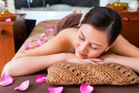 sensual massage: Chinese Woman having wellness massage
