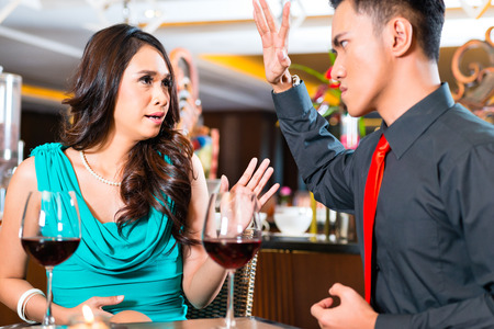 breaking up: Asian Couple arguing in restaurant Stock Photo