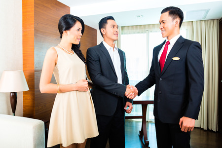 Manager greeting guests in hotel