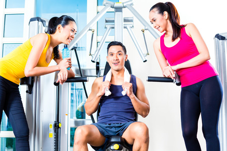 Women and man talking at gym photo