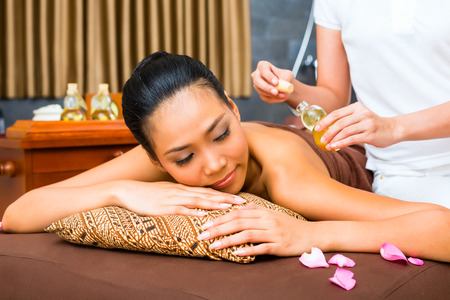 Beautiful Asian woman receiving massage in Spa photo